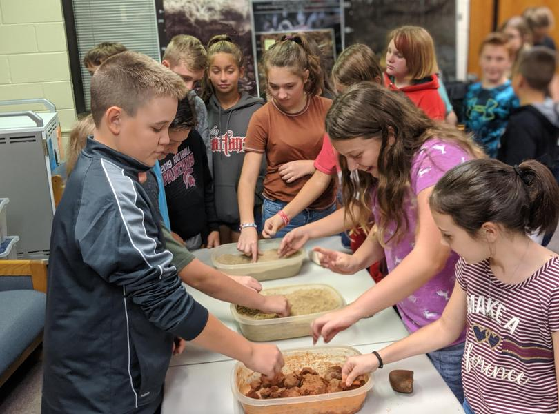 6th Grade Students working with Soil