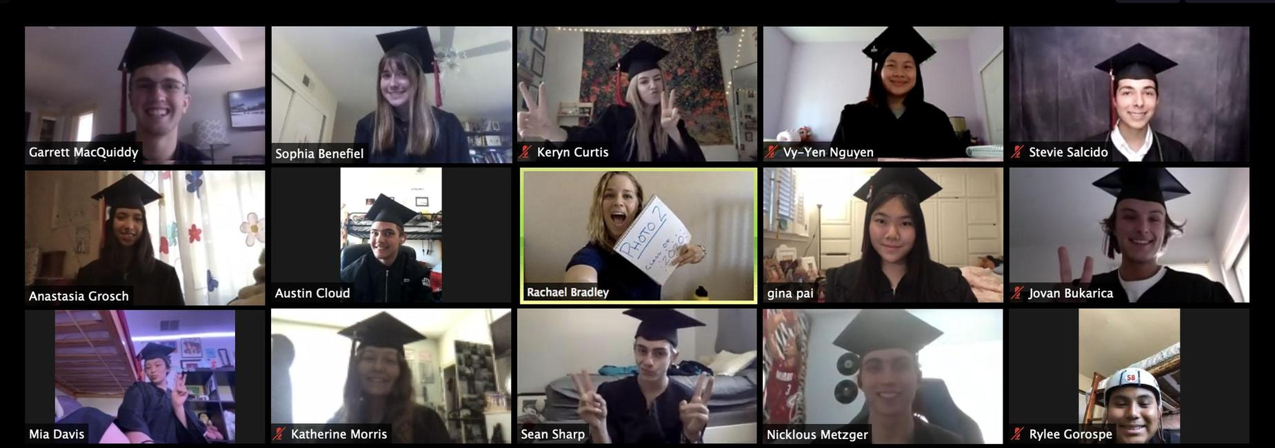 A screenshot of 2019-2020 students in their graduation gowns on a zoom call.