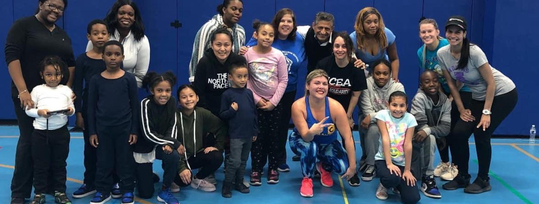 Children, parents and staff pose after a fitness class led by our teacher and Zumba instructor, Ms. Ley.