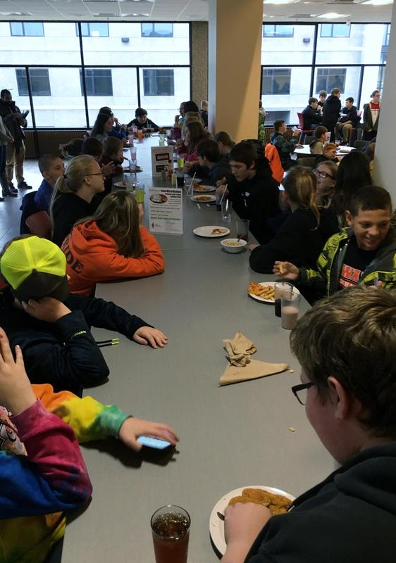 Students eating lunch in the cafeteria.