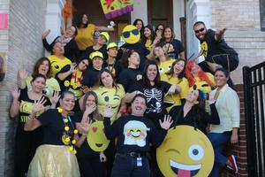 Jefferson teachers and staff dressed as different emojiis acting like their emojii costume