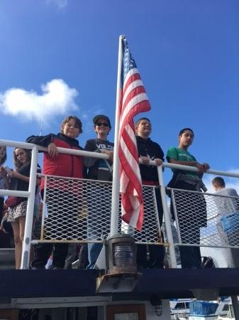 Middle School boys and US flag on boat