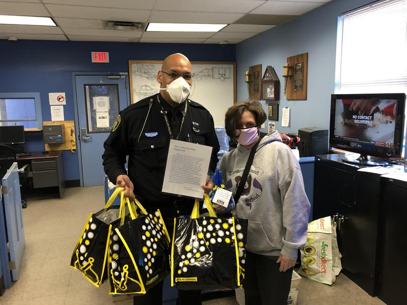 Ms. Cerullo and UCPD holding goodies for the officers
