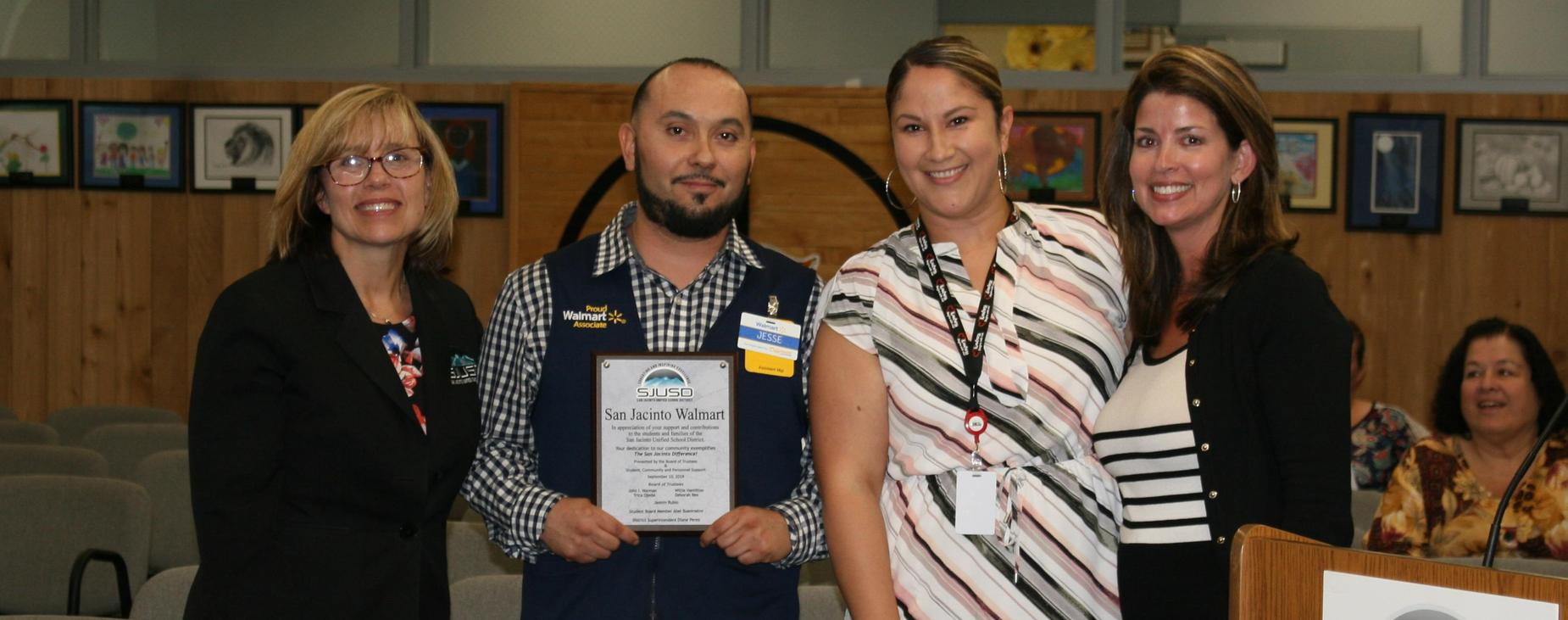 L-R, Dep. Superintendent Smith, Specialist Adame and Director Dr. Kirschinger recognize SJ Walmart Assistant Manager Jesse for contributions to students and families at SJUSD.