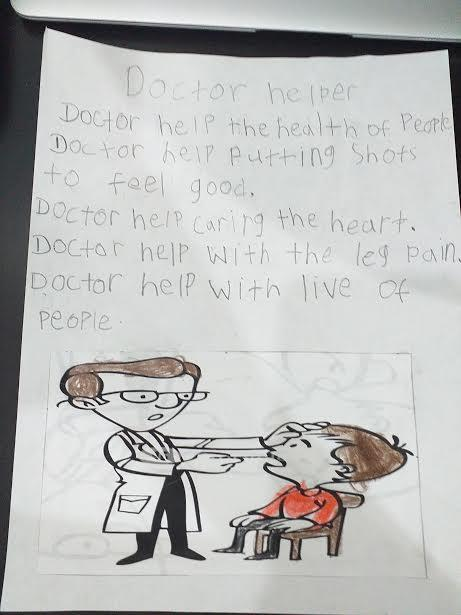 Doctor with patient drawing and explanation