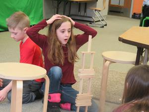 Lee second-grader Caitryn Hilton is in awe her tower of Keva Planks is still standing.