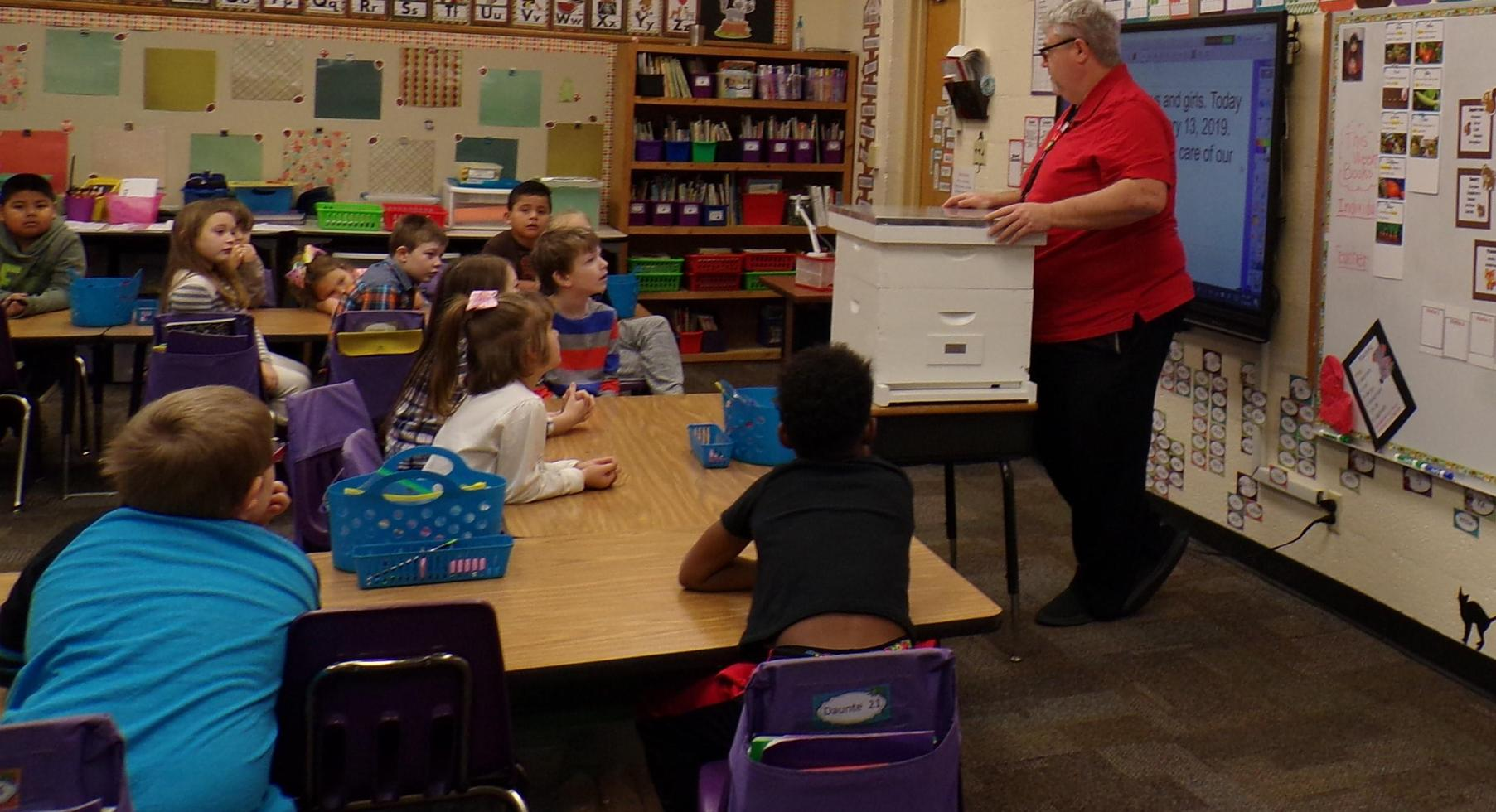 Mr. Chapman explains beekeeping to 1st grade.