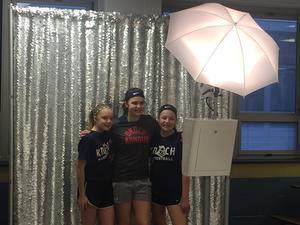 Kids in photo booth at 6th grade fun night