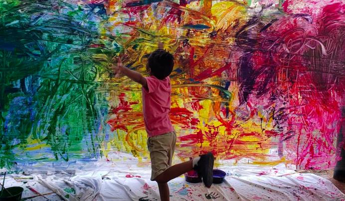 student joyously painting