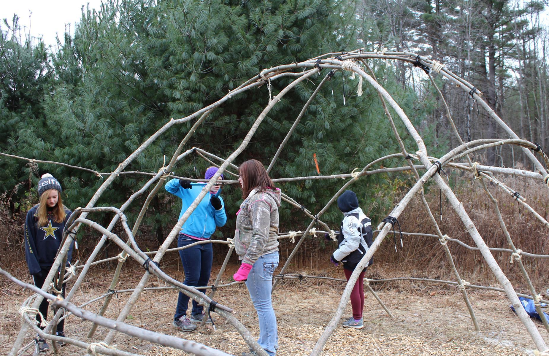 students building a wigwam