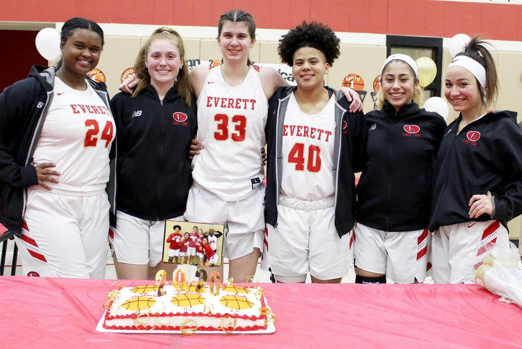 Senior players at a table with a basketball-themed cake