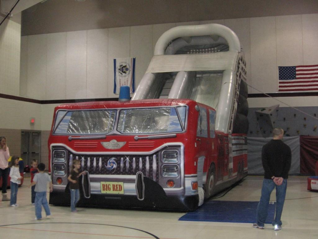 giant inflatable fire truck in gym