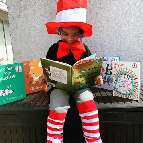Student reading a Dr. Seuss book