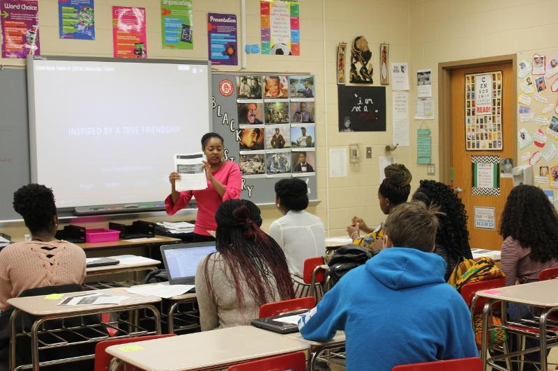 photo of minority high school teacher teaching her class