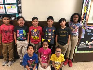 9 kids showing off their super hero t's