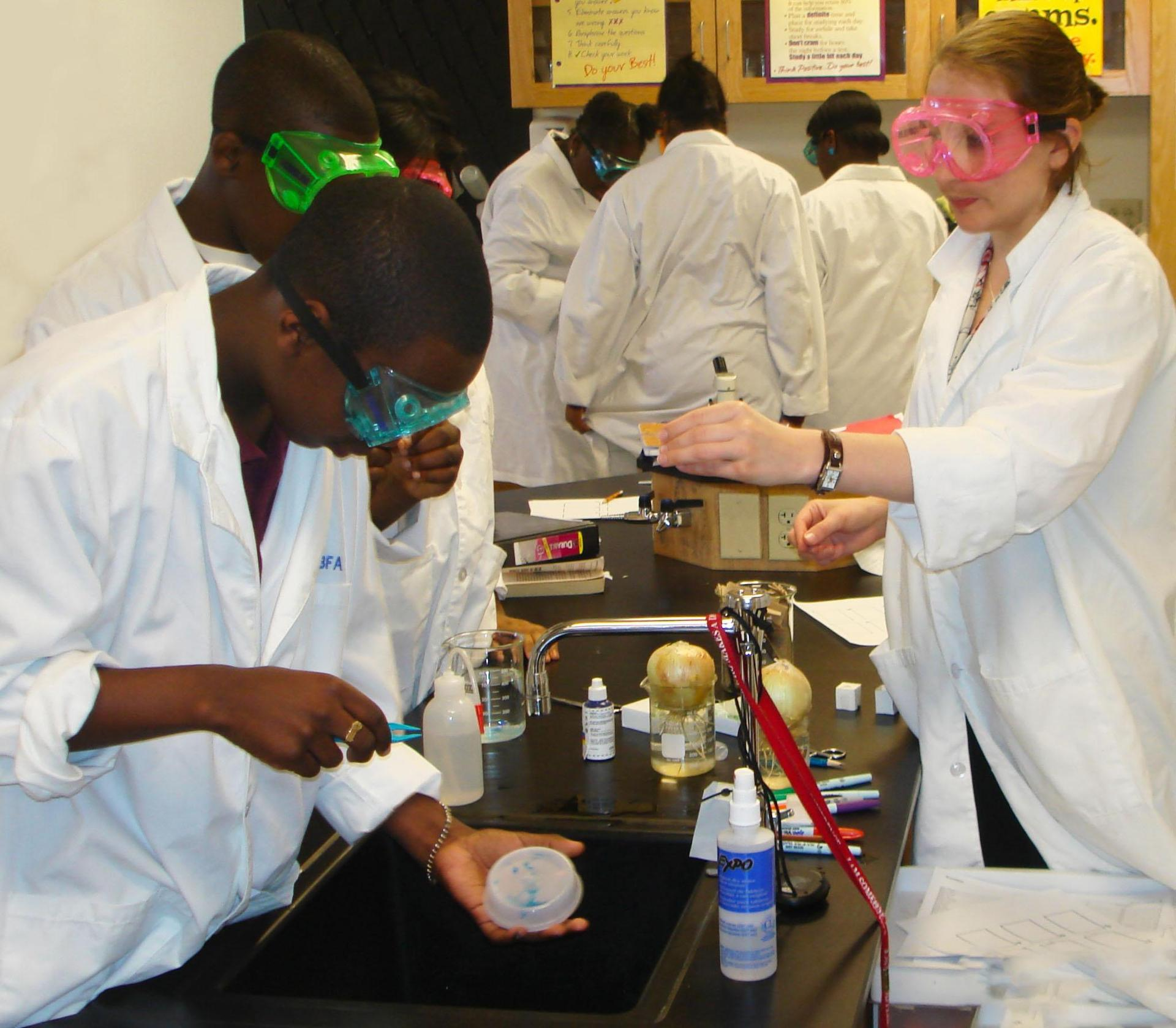 Middle School students carrying out an experiment in the science lab