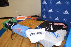 JHS displays swag from UT-Dallas and SWOSU