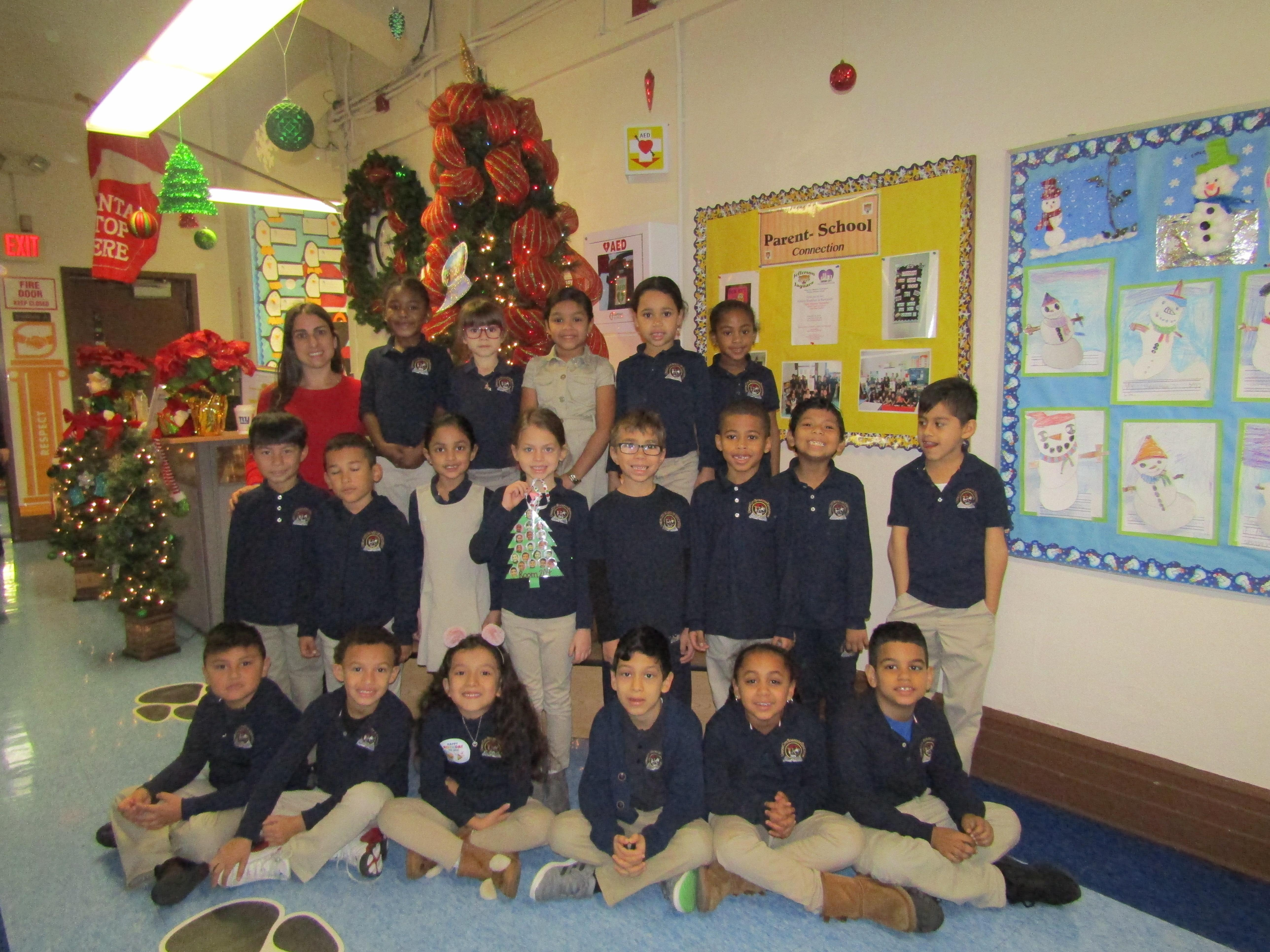 first grade class in front of Christmas Tree