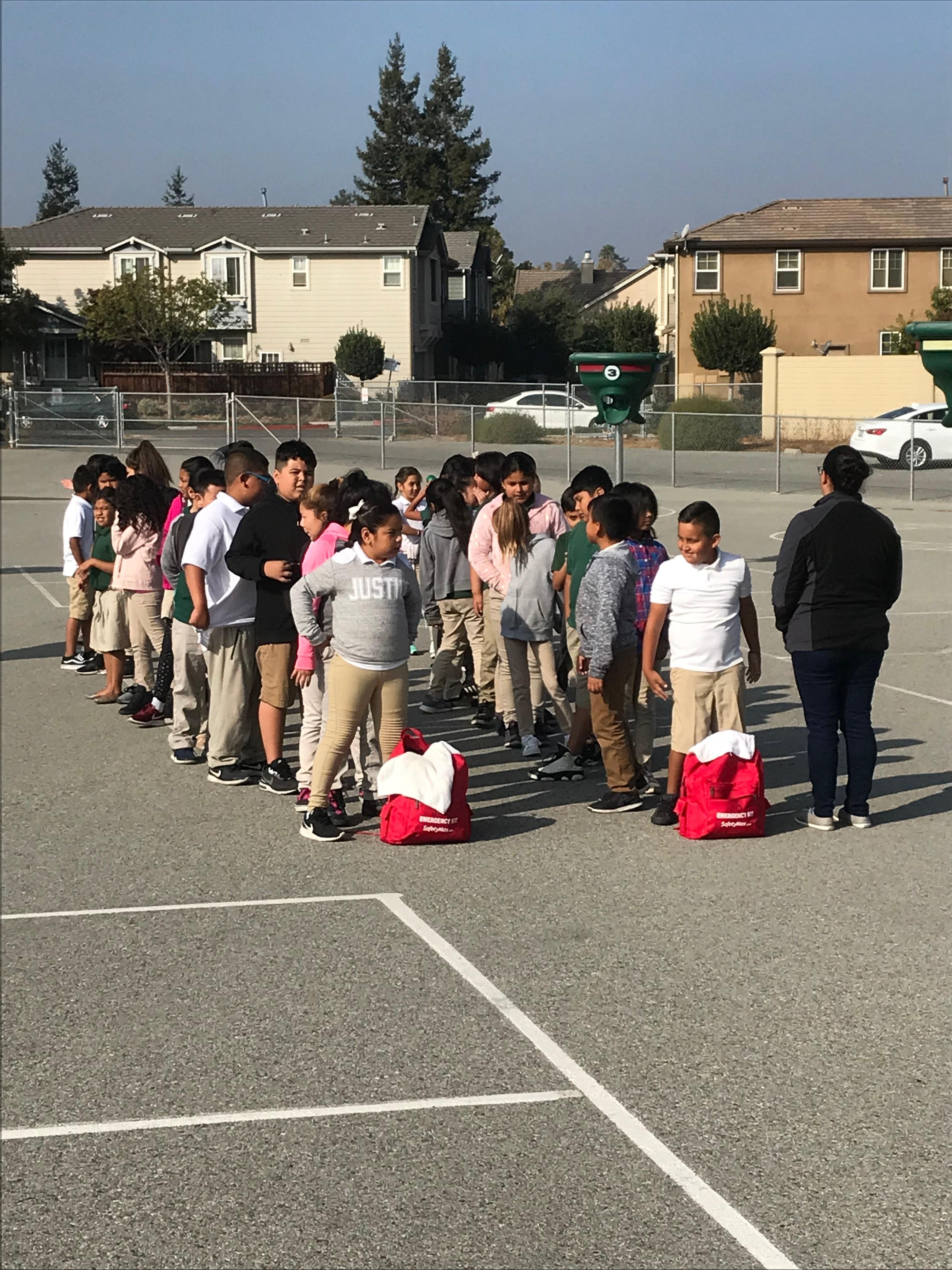 4th grade students lined up on blacktop