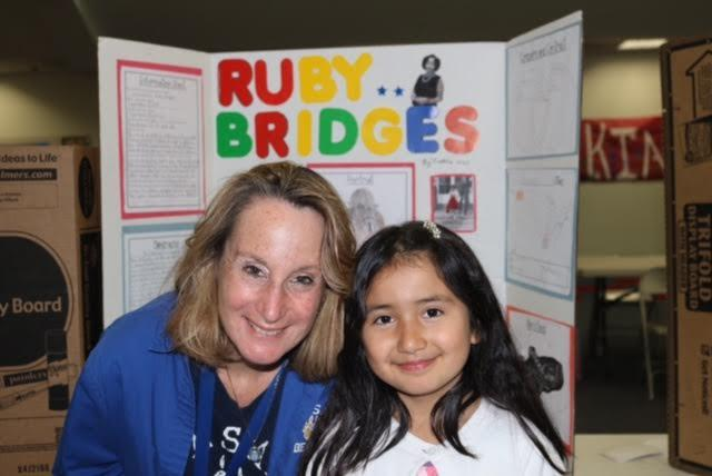 Principal Dr. Groth with a student presenting during the 3rd grade wax museum.