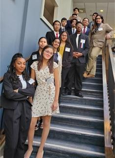 JSA Team at the Fall Debate Competition standing on the stairway together