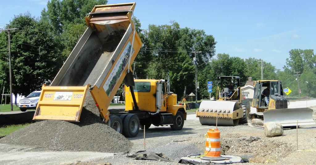 A dump truck delivers a load of stone August 13, 2018