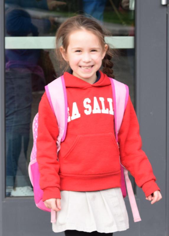 little girl with backpack on and La Salle sweatshirt