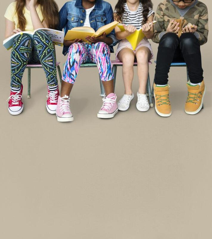 Children wearing socks and tennis shoes