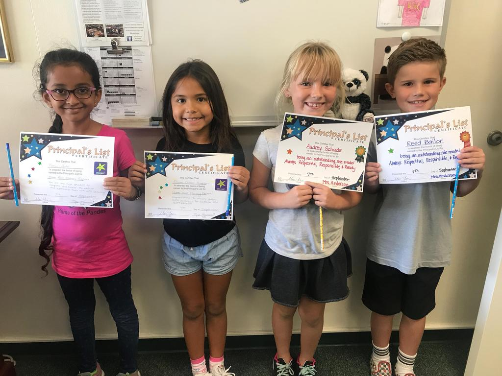 Four students receiving a Principal's award