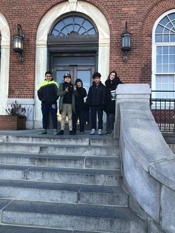 Mrs. Alonso and her class in front of the Main UC post office