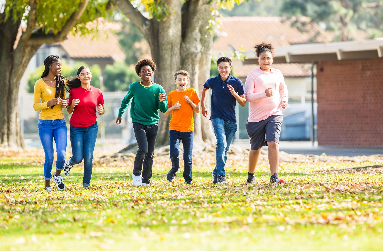 students walking on campus field