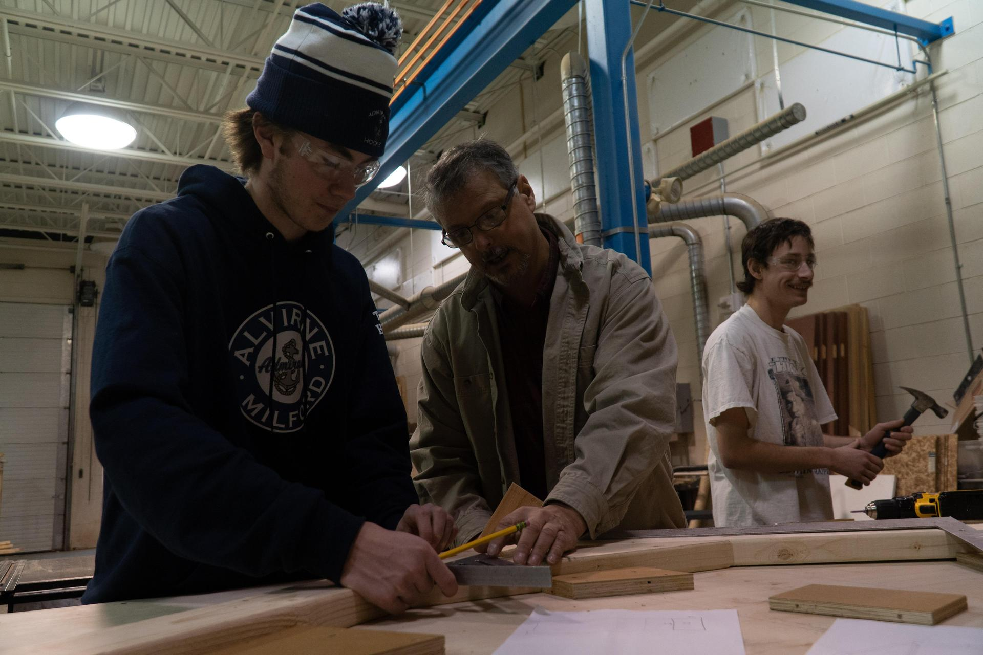 Student and Mr. Carter building