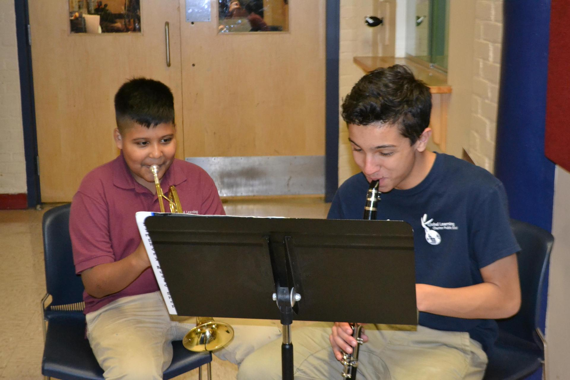 Students practicing their instruments.