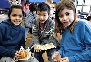 Photo of three Tamaques 2nd graders working together on bridge design challenge during STEAM Day.