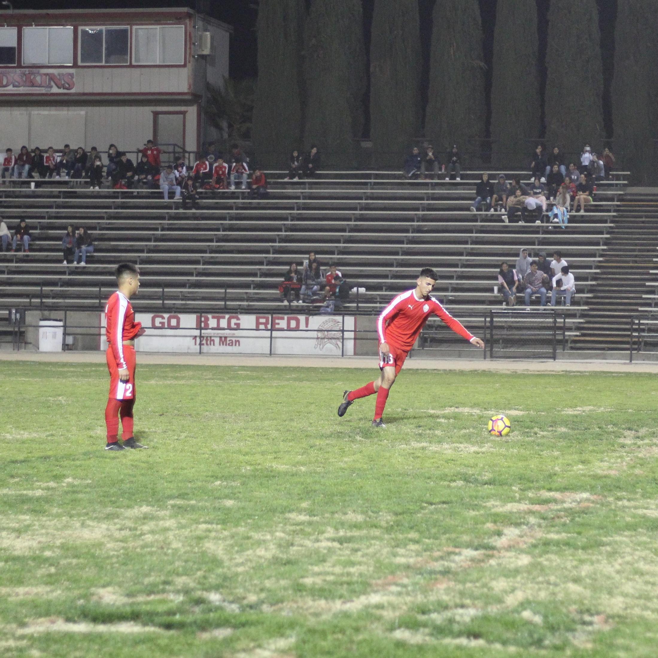 Christian Fernandez running to kick the ball