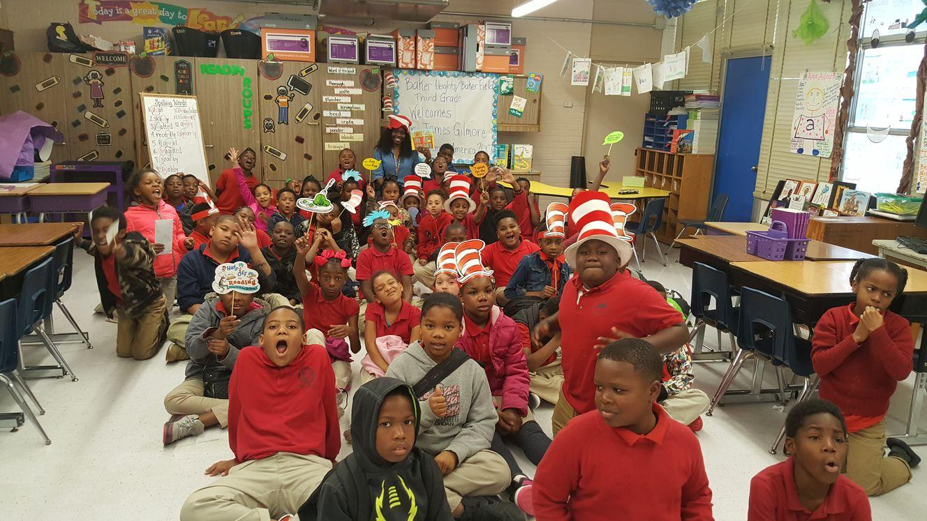 big group of children excited about reading