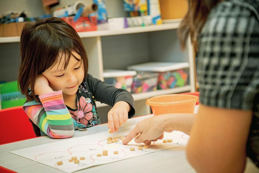 HudsonWay Immersion School preschooler learning basic math concepts through manipulatives