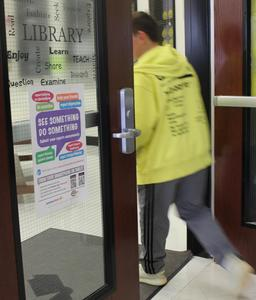 Anonymous Alerts information posted at middle school library entrance