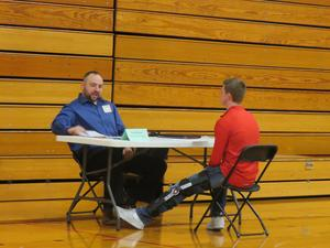 A TKHS senior takes part in mock job interviews with volunteers from different organizations and companies.
