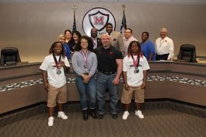 MISD Board members with MHS Powerlifters Jayla Quichocho, Jeremiah Thompson and Journey Thompson