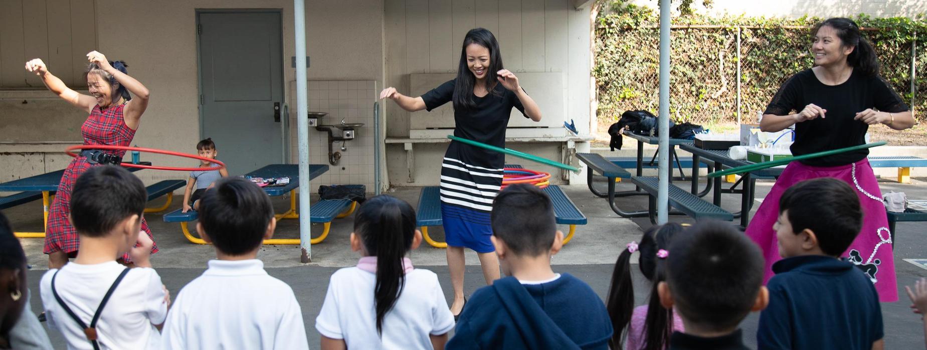 Northrup Teachers and Principal hula hooping