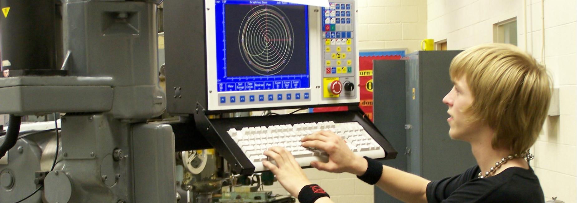 Smyth Career & Technology Center student using CNC machine.