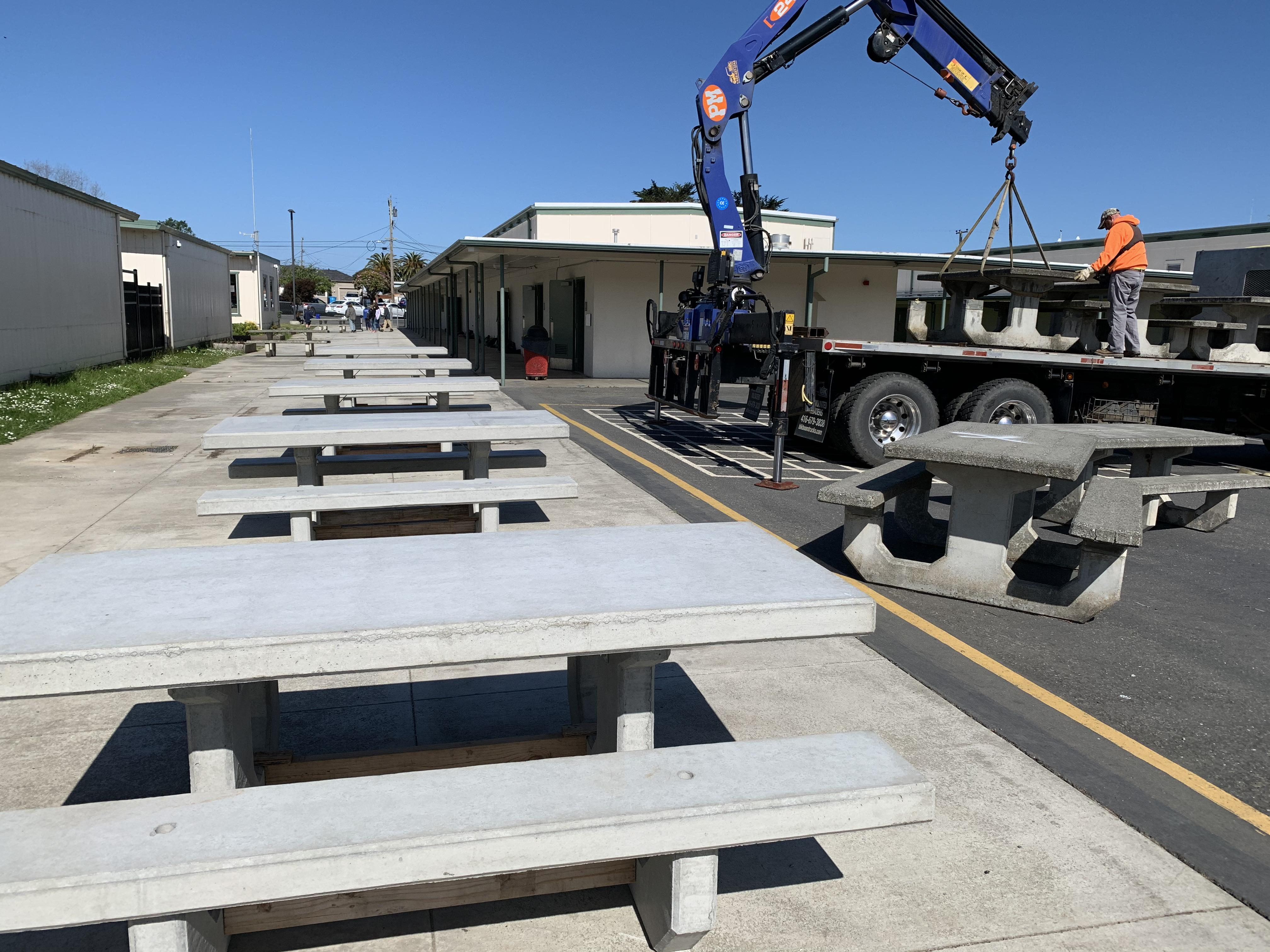 picnic tables and crane