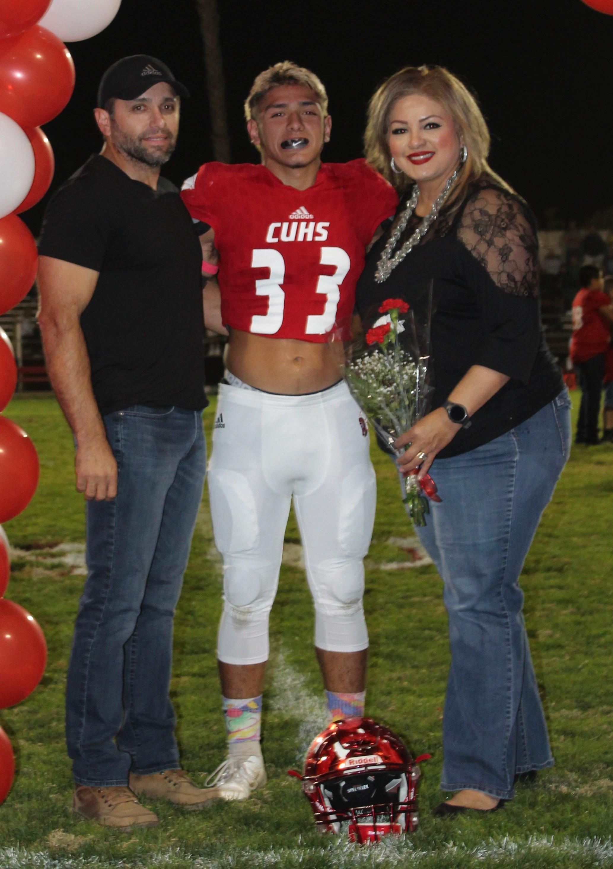 Luciano Manzo and his supporters at Senior Night.