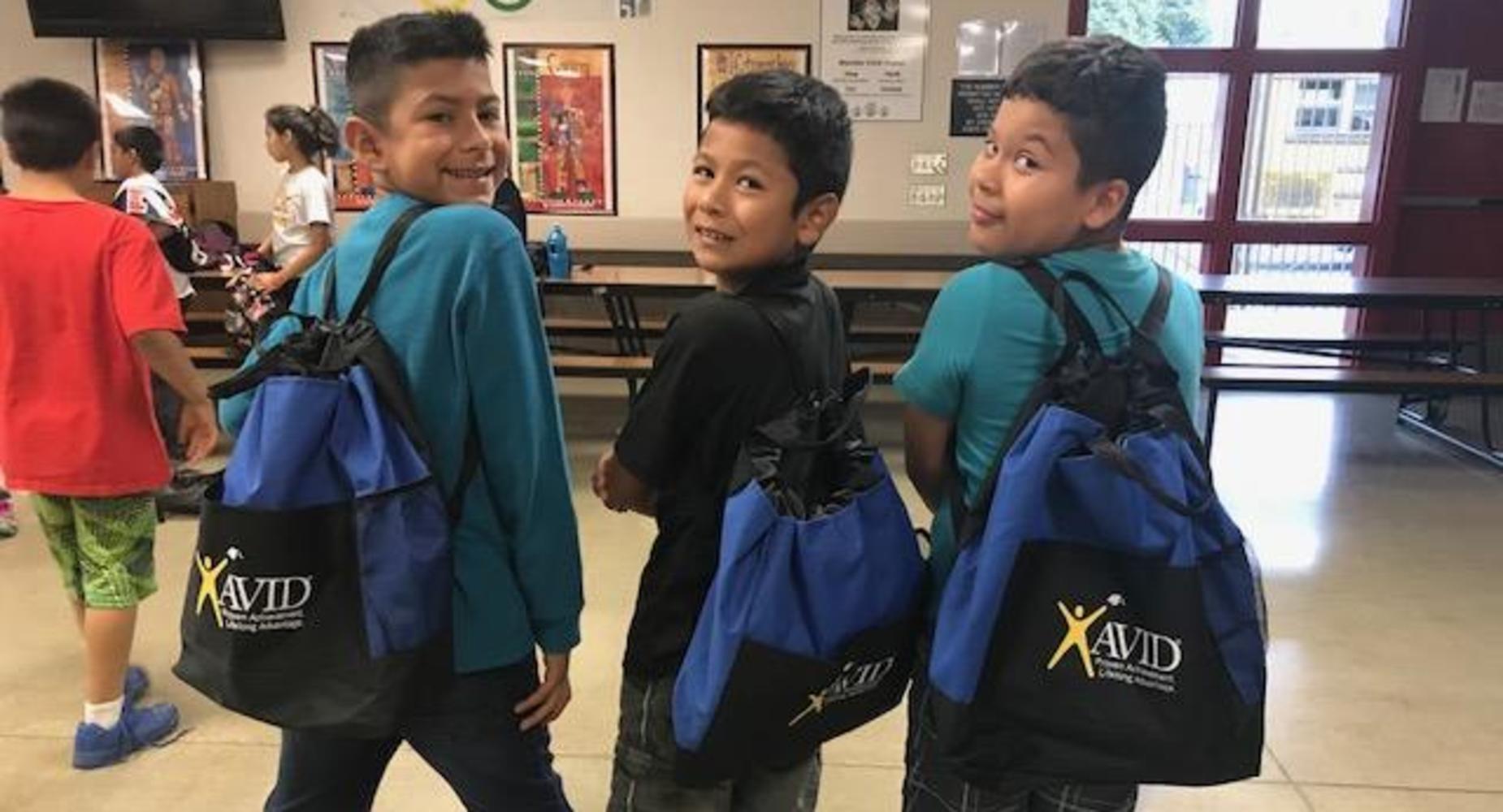 3 boys wearing their AVID backpacks.