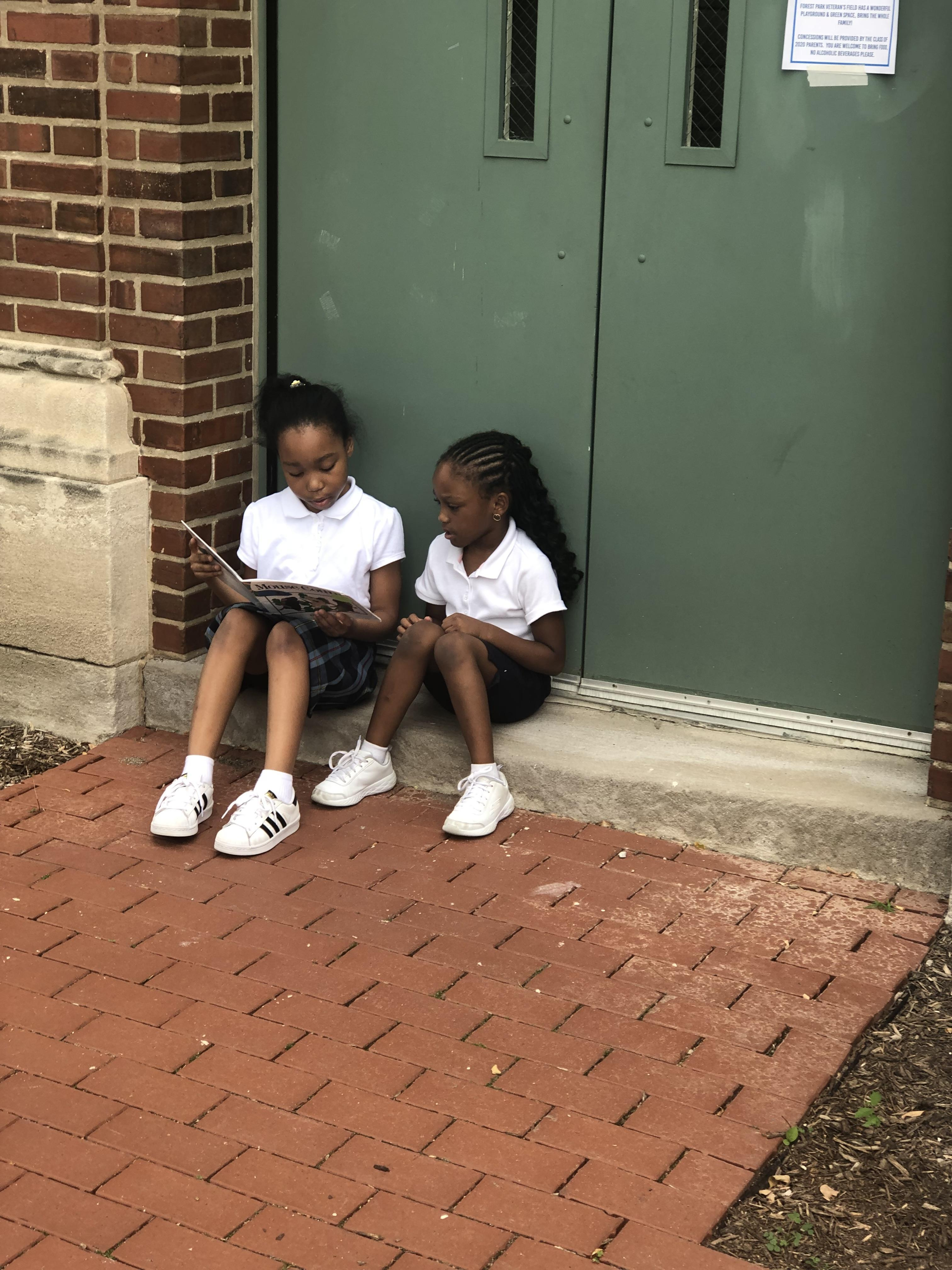 Reading outside with our buddies.