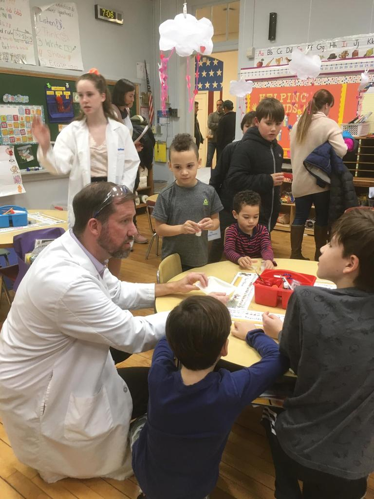 Photo of parent volunteer sharing expertise with students during McKinley's annual STEM Night.