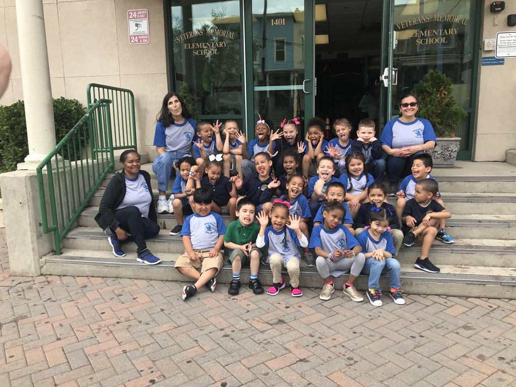 group photo of Ms. Q's class enjoying a cold treat