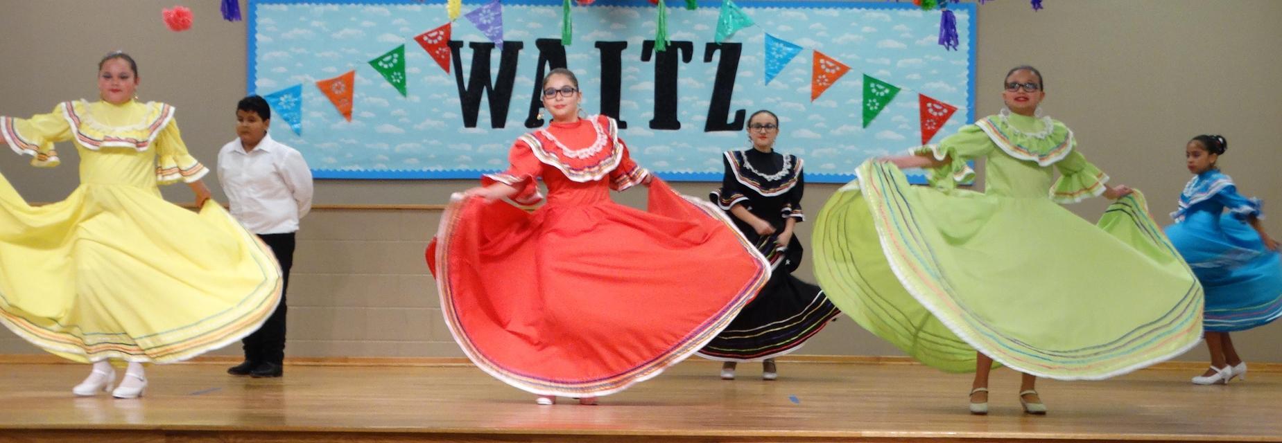 folklorico dancers on stage
