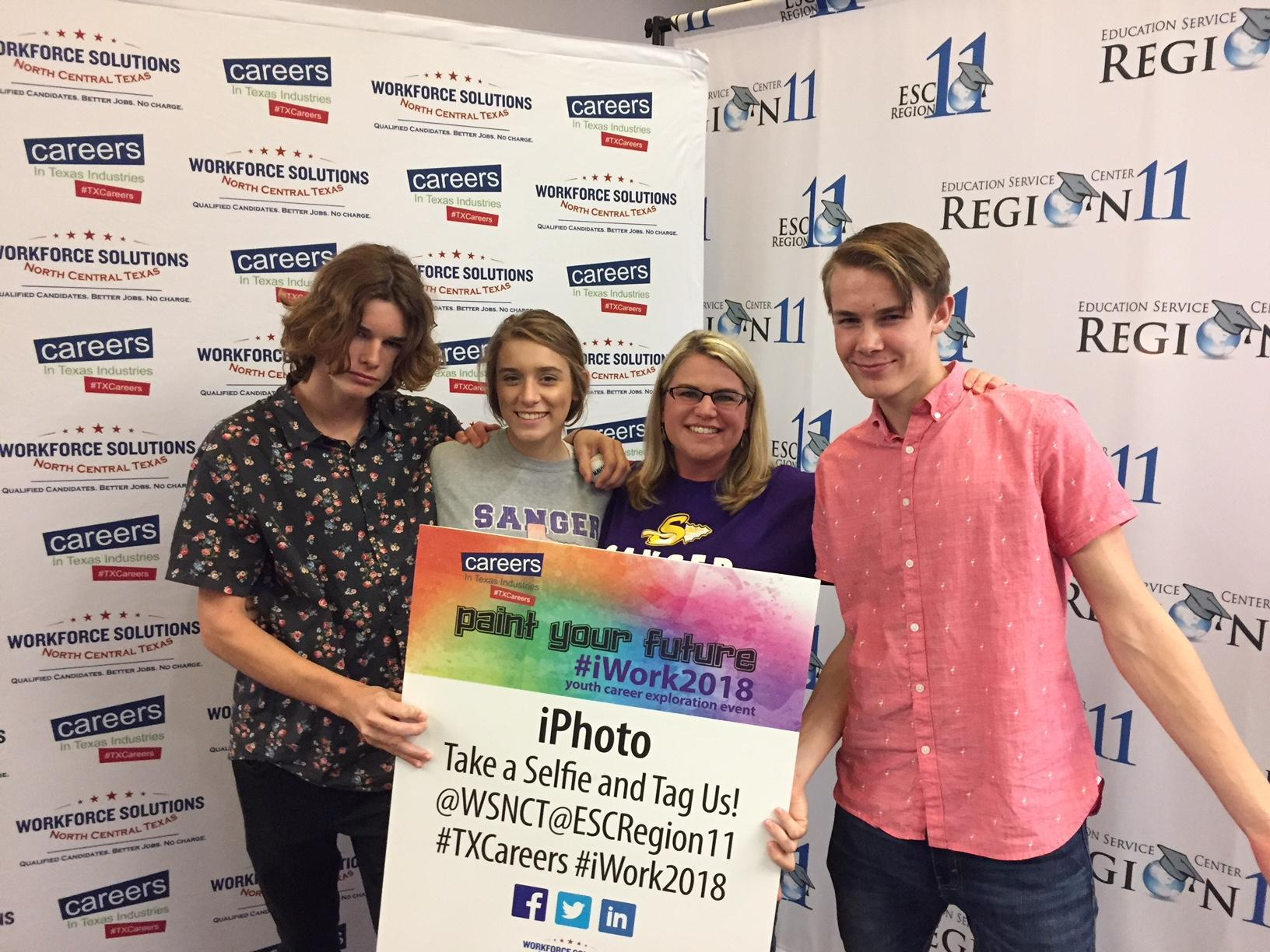 Mrs. J Reynolds posing with a few students on the iWork Field Trip